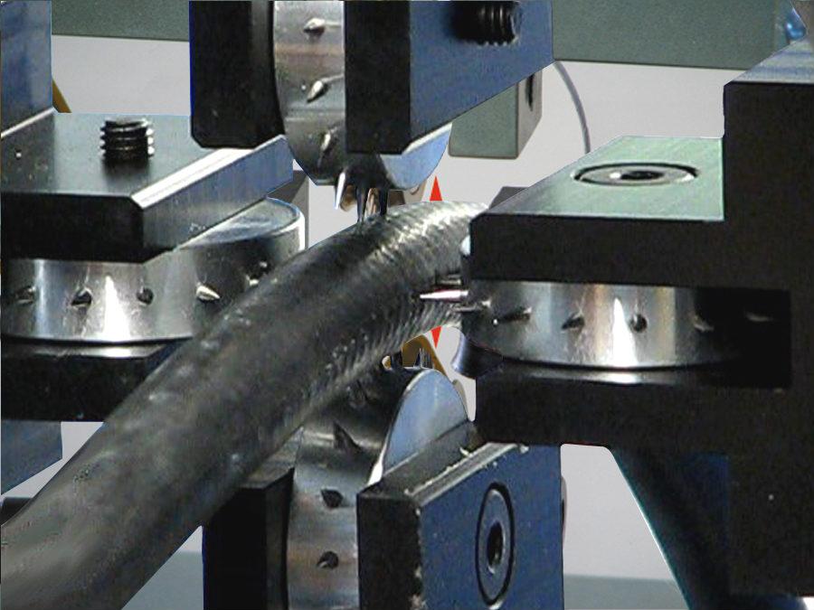 Close-up van het pinprikken van een hydrauliekslang